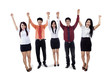 Business team raised hands in victory