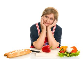 Elderly woman cooks food