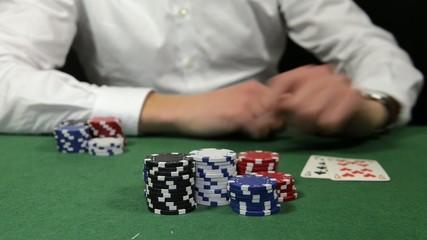Poker player winning the pot