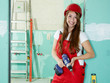 Female Apprentice  with cordless screwdriver has a break