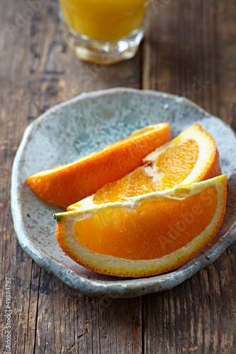 Fresh oranges on a plate