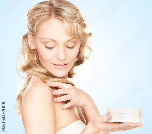 beautiful woman with moisturizing creme