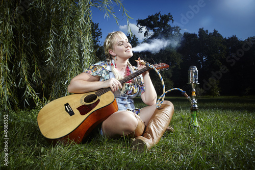 Smoking hippie with guitar
