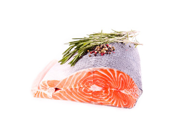 Raw salmon steak with rosemary