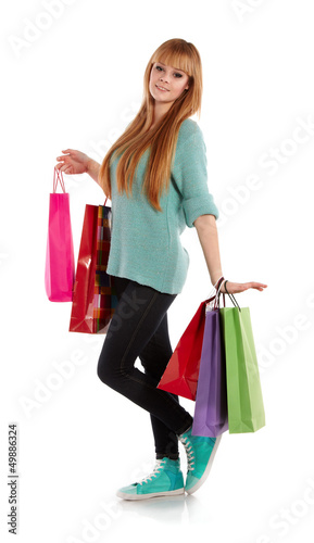 girl with shopping bags , isolated on white background