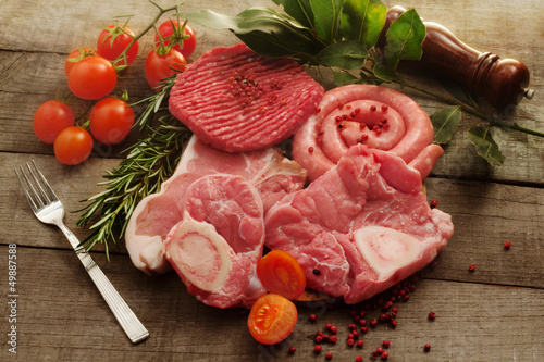 raw meat selection over rough wood