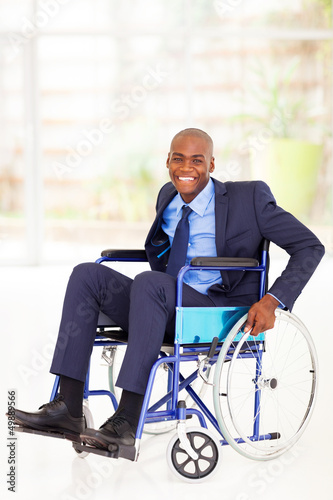 optimistic disabled african american businessman on wheelchair