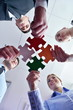 Group of business people assembling jigsaw puzzle