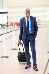 handsome african business traveller in airport