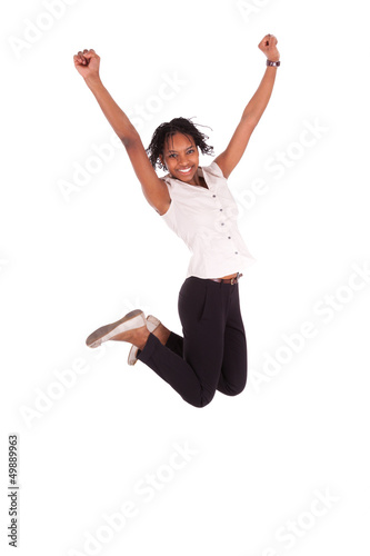 Young african american business woman jumping, success concept