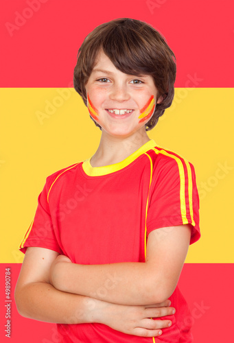Spanish boy with t-shirt team and Spain flag