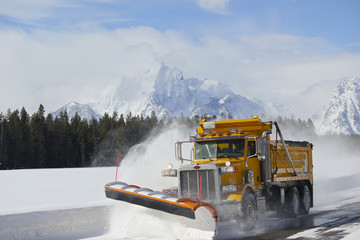 Snow Plow dump truck in Teton national park after blizzard