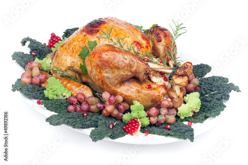 Garnished roasted turkey on white