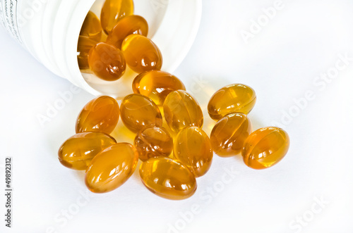 Rice bran oil pills pouring from the bottle