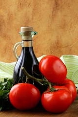 bottle of balsamic vinegar and fresh tomatoes