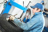 repairman mechanic lubricating car tyre poster