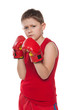 Young boy in boxing gloves