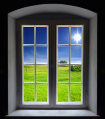 Window and summer landscape