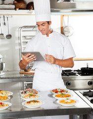 Happy Chef Using Digital Tablet