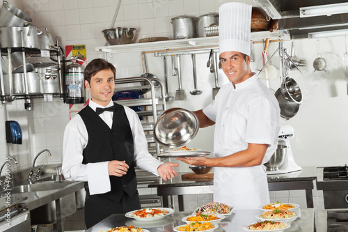 Waiter Taking Customer's Food From Chef