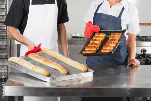 Chefs Holding Trays Of Baked Bread