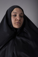Woman covered with black veil