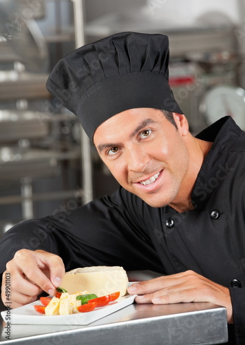 Happy Chef Garnishing Dish