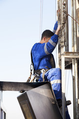 Men at work climbing rig