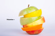 Apfel Zitrone Orange gemischt aufgestapelt mit Spruch Vitamin +