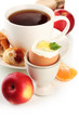 Light breakfast with boiled egg and cup of coffee, isolated