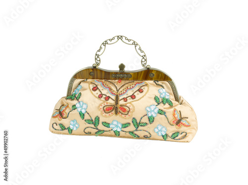 A luxury lady handbag decorated by colorful beads.