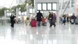 blurred passengers at an airport