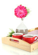 Cups of tea with flower on wooden tray isolated on white