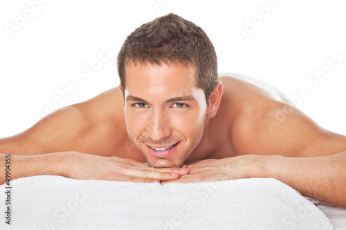 Happy young man after a massage