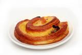 Homemade bun with raisins on a plate