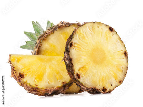 Juicy slices of pineapple fruits isolated on white background