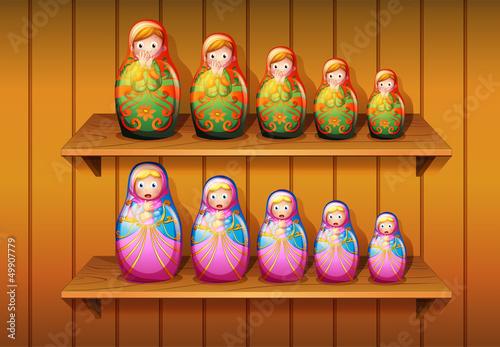 Dolls arranged in the wooden shelves