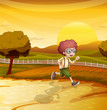 A sunset view with a boy running