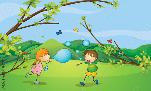 Kids playing blowing bubbles