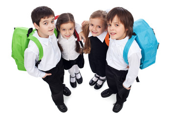 Happy school kids with back packs