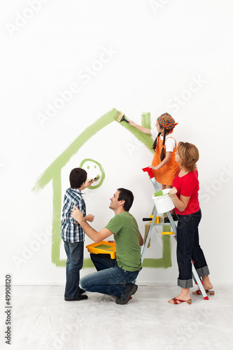 Happy family painting their home together