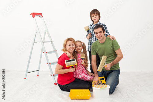 Happy people preparing to paint their home