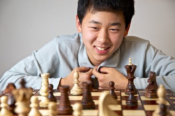 Teenager Playing Chess