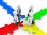 Four businessmen meet on puzzle crossroad