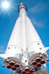 Space transport rocket against blue sky