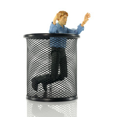 puppet in black metal bin