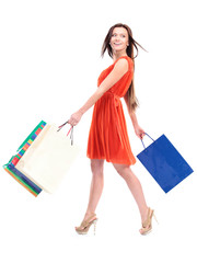 Portrait of young happy smiling woman with shopping bags