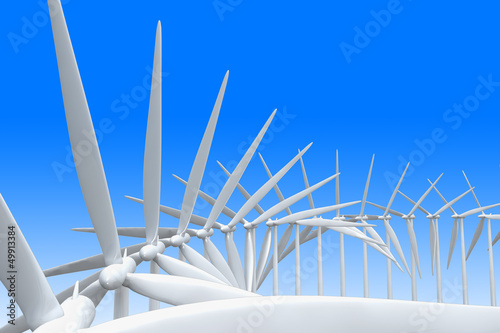 Modern windmills with the blades turning together at slightly