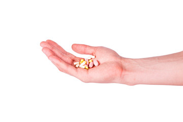Male hand holding a handful of medical pills