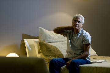 Mature man in bed